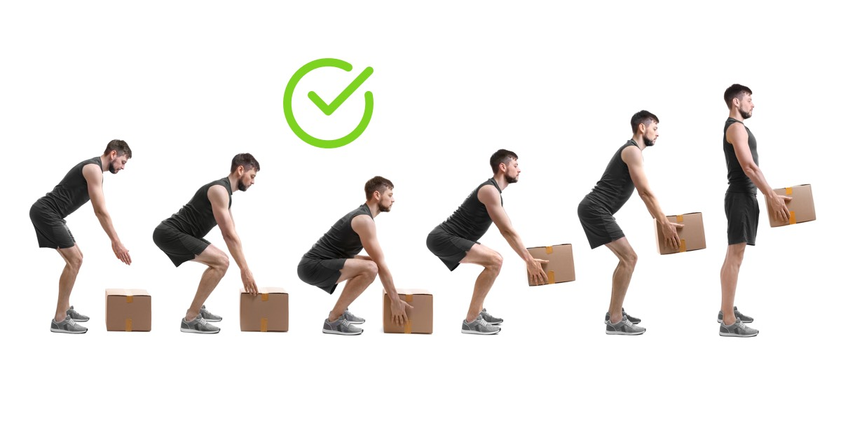 Man correctly listing cardboard box of objects with good posture