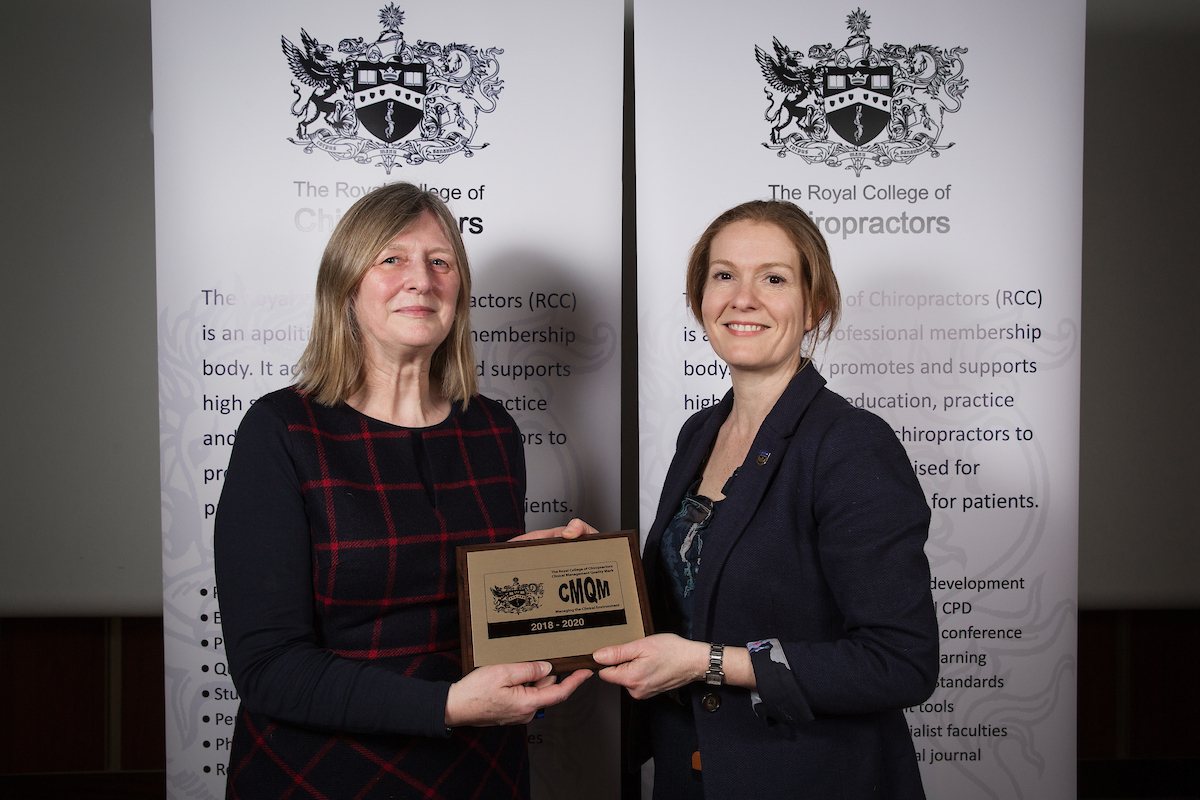 Rebecca accepting CMQM award at Royal College of Chiropractors - AGM